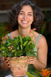 Hispanic woman gardeningの写真素材 [FYI01996536]