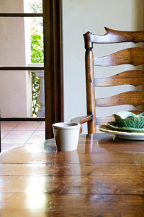 Wooden Chair at Table with Place Settingの写真素材 [FYI01996600]