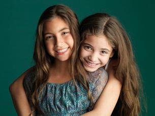 Close up of sisters huggingの写真素材 [FYI01996828]