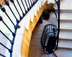 Winding Stone Staircase with Wrought Iron Railingの写真素材 [FYI01997552]