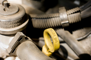 Close up of engine oil dipstick handleの写真素材 [FYI01997644]