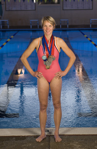 Female swimmer wearing medalsの写真素材 [FYI01997645]