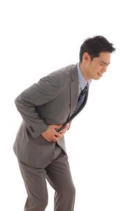体調不良で苦しむ会社員の写真素材 [FYI02021690]