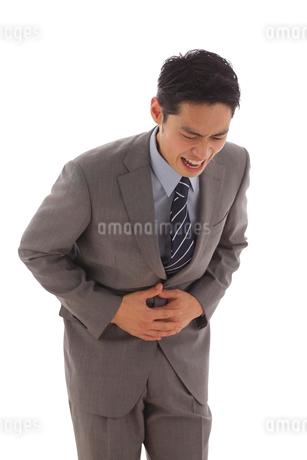 体調不良で苦しむ会社員の写真素材 [FYI02023857]