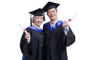 卒業生姿の老人の写真素材 [FYI02042577]