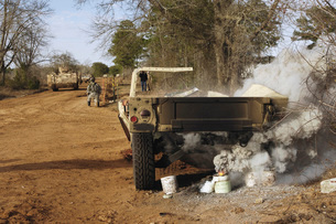 A humvee burns after a simulated roadside bomb explosion.の写真素材 [FYI02098882]