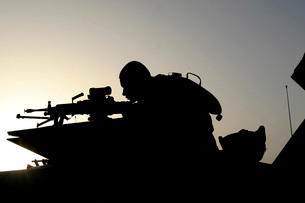 Silhouette of a Squad Automatic Weapon gunner.の写真素材 [FYI02098907]