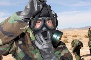 Rifleman puts on his gas mask.の写真素材 [FYI02098990]