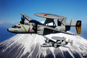 Two E-2C Hawkeyes conduct a flyby of Mount Fuji in Japan.の写真素材 [FYI02099121]