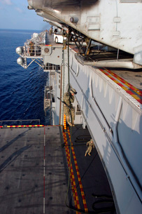 Marines and sailors fast-rope from the rear of a CH-46E Seaの写真素材 [FYI02099233]