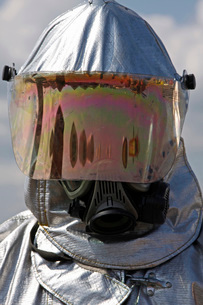 Close-up view of a firefighter in a fire proximity suit.の写真素材 [FYI02099302]