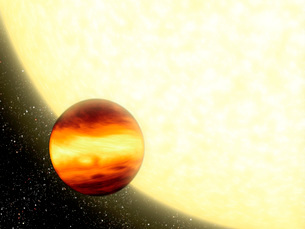 A gas-giant planet orbiting very close to its parent star.の写真素材 [FYI02099364]
