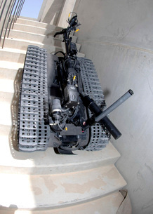 A Talon 3B robot unit climbing a flight of stairs during a tの写真素材 [FYI02099369]