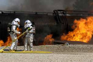 Firefighters neutralize a live fire.の写真素材 [FYI02099426]