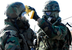 Soldiers help each other during a decontamination process.の写真素材 [FYI02099495]