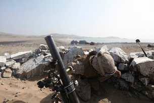 A U.S. Marine fires a mortar in Salinas, Peru.の写真素材 [FYI02099529]