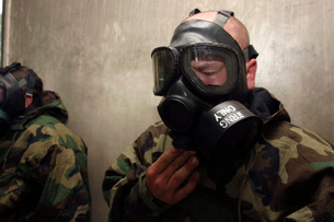 A field radio operator clears CS gas from his gas mask at thの写真素材 [FYI02099729]