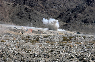 A round from an AT-4 small rocket launcher impacts on Rangeの写真素材 [FYI02099743]