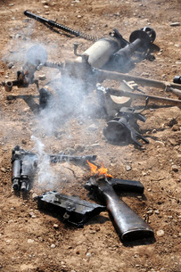 Pieces of enemy weapons lay out to cool off after being de-mの写真素材 [FYI02099813]