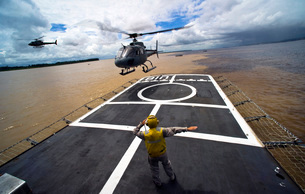 A Brazilian Eurocopter prepares to land aboard a Brazilian nの写真素材 [FYI02100426]