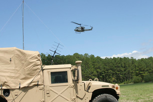 A UH-1N helicopter flies over the Marine Air Support Squadroの写真素材 [FYI02100440]