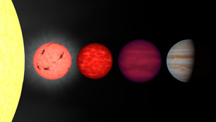 An artist's rendition comparing brown dwarfs to stars and plの写真素材 [FYI02100468]