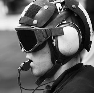 A Sailor supervises flight operations aboard the aircraft caの写真素材 [FYI02101014]