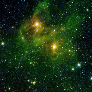 Two extremely bright stars illuminate a greenish mist in deeの写真素材 [FYI02101712]