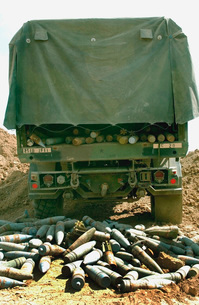 The ammunition cache unloaded in a crater for preparation foの写真素材 [FYI02102269]