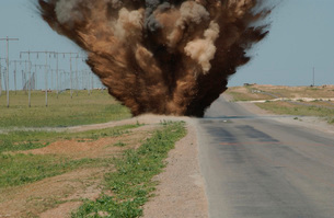 An Improvised Explosive Device destroyed by C-4 explosives.の写真素材 [FYI02102386]