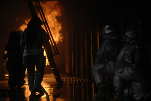 Firefighters extinguish a simulated cargo fire at RAF Mildenの写真素材 [FYI02102405]