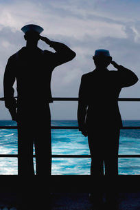 Seamen salute the resting place of USS Lexington.の写真素材 [FYI02102556]