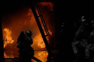 Firefighters extinguish a simulated cargo fire at RAF Mildenの写真素材 [FYI02102975]