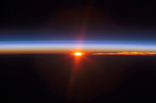 Layers of Earth's atmosphere, brightly colored as the sun seの写真素材 [FYI02103159]