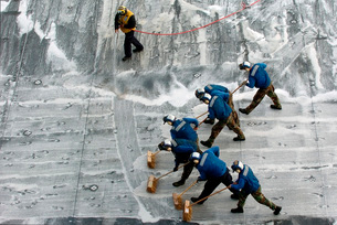 Sailors conduct a Scrub Exercise on the flight deck aboard Uの写真素材 [FYI02103166]