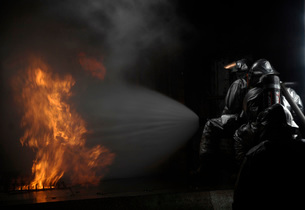 Firefighters extinguish a simulated cargo fire at RAF Mildenの写真素材 [FYI02103309]