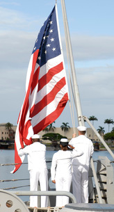Sailors hoist the American flag for morning colors aboard thの写真素材 [FYI02103407]