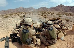 A marine fires his M2 .50 caliber heavy machine gun.の写真素材 [FYI02103441]