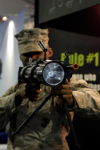 A marine tests the Night Hunter II, a rifle mountable flashlの写真素材 [FYI02103695]
