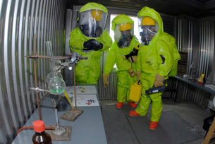 Specialists survey a simulated area during a HAZMAT exerciseの写真素材 [FYI02103699]