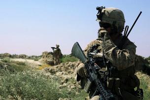 U.S. Marine uses a radio during a security patrol in Afghaniの写真素材 [FYI02103729]
