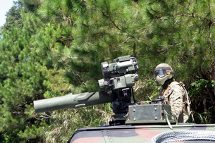A tube-launched, optically-tracked, wire-guided missile gunnの写真素材 [FYI02103931]