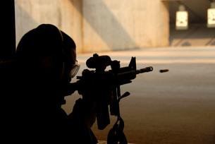 An Airman tests his skills at the shooting range.の写真素材 [FYI02104126]