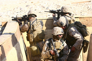 A team of Recon Marines assaults a trench system.の写真素材 [FYI02104407]