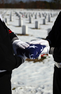 Marines perform flag folding honors for a funeral service.の写真素材 [FYI02104440]