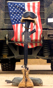 An M16-A2 service rifle, a pair of boots and a helmet standの写真素材 [FYI02104553]