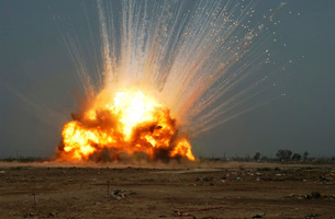 A cache of unexploded ordnance is detonated.の写真素材 [FYI02104652]