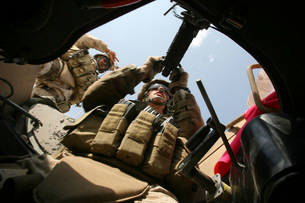 A marine rocks his M-2 .50-caliber machine gun.の写真素材 [FYI02104700]