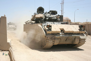 An M2 Bradley Fighting Vehicle patrols past Command Post Hitの写真素材 [FYI02104920]