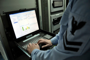 Information Systems Technician monitors network activity froの写真素材 [FYI02104990]